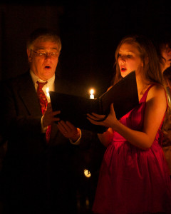 Image of Art and Emily singing in candlelight