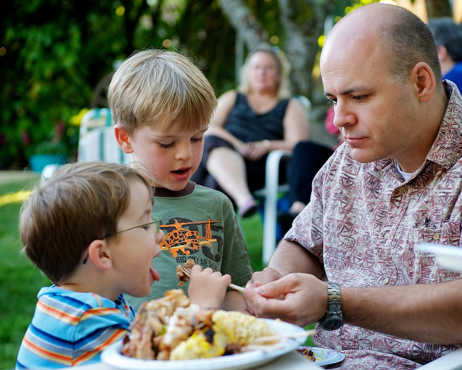 Image of a dad and two children at the church picnic