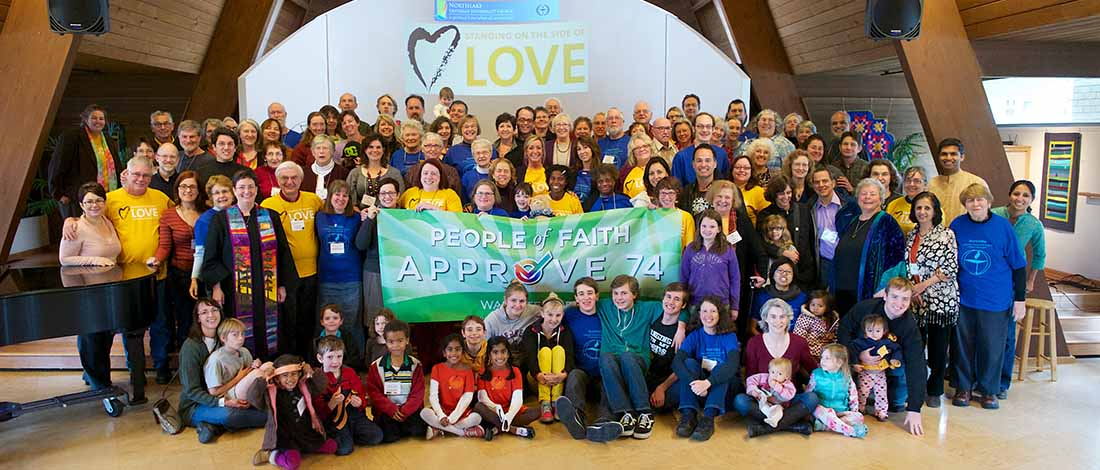 Image of all the congregants with banner