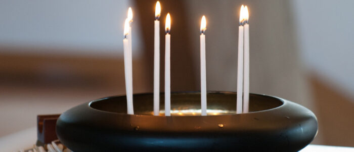 Image of candles burning in a presentation bowl