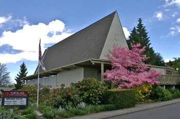 Image of exterior of sanctuary and flag