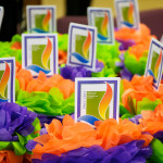 Image of bright orange, green and purple anniversary flowers