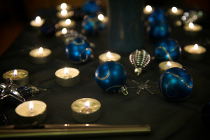 Image of blue Christmas candles on a dark background