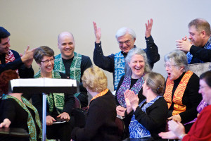 Image of choir members laughing with each other