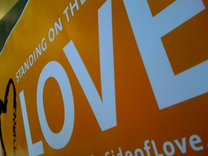 Image of part of the Standing on the Side of Love poster highlighting the word love