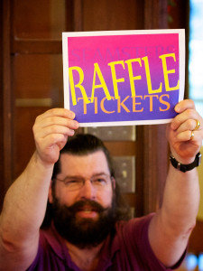 Member of the Seamsters holding up Raffle sign
