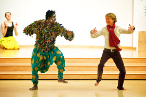 Image of 2 people in costume dancing Awal and Erika