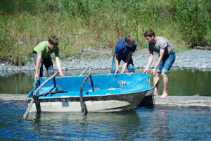 Image of 3 Northlake youth members boating during camping trip