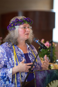 Image of Robin Brewer wearing flowers in her hair