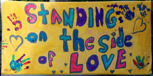 Image of a hand-painted Standing on the Side of Love poster