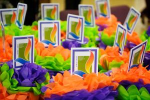 Image of bright orange, green and purple anniversary flowers