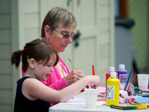Image of child and adult working on an art project together